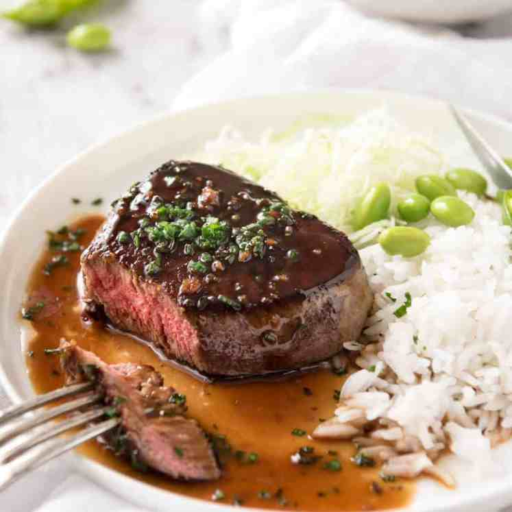Simple yet stunning Asian Steak with a sauce inspired by the great Tetsuya! All you need is 15 minutes, soy sauce, mirin, sake or sherry, butter, garlic and ginger. Amazing! www.recipetineats.com