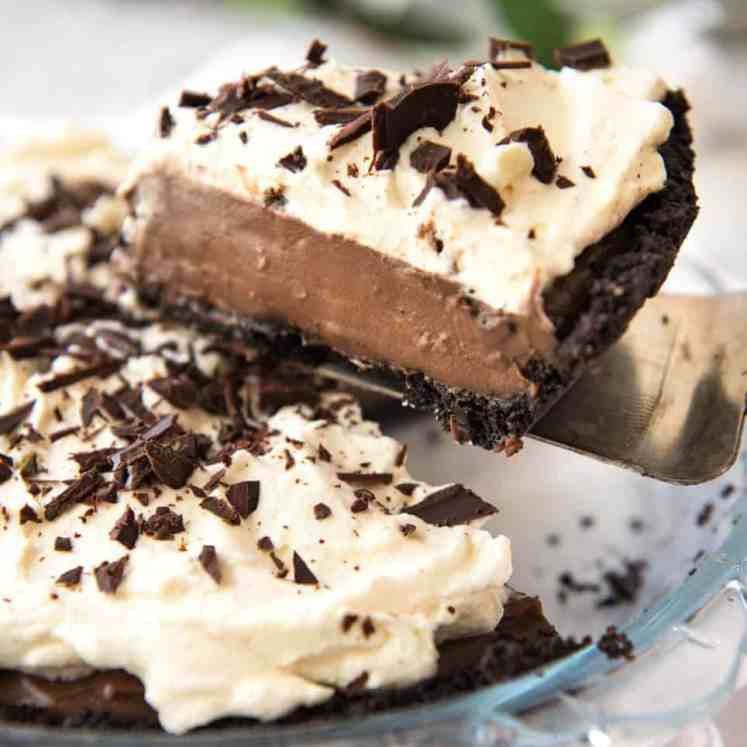 And easy, magnificent Chocolate Cream Pie with a biscuit base, soft custard-like chocolate filling and topped with clouds of cream. Recipe video included! recipetineats.com