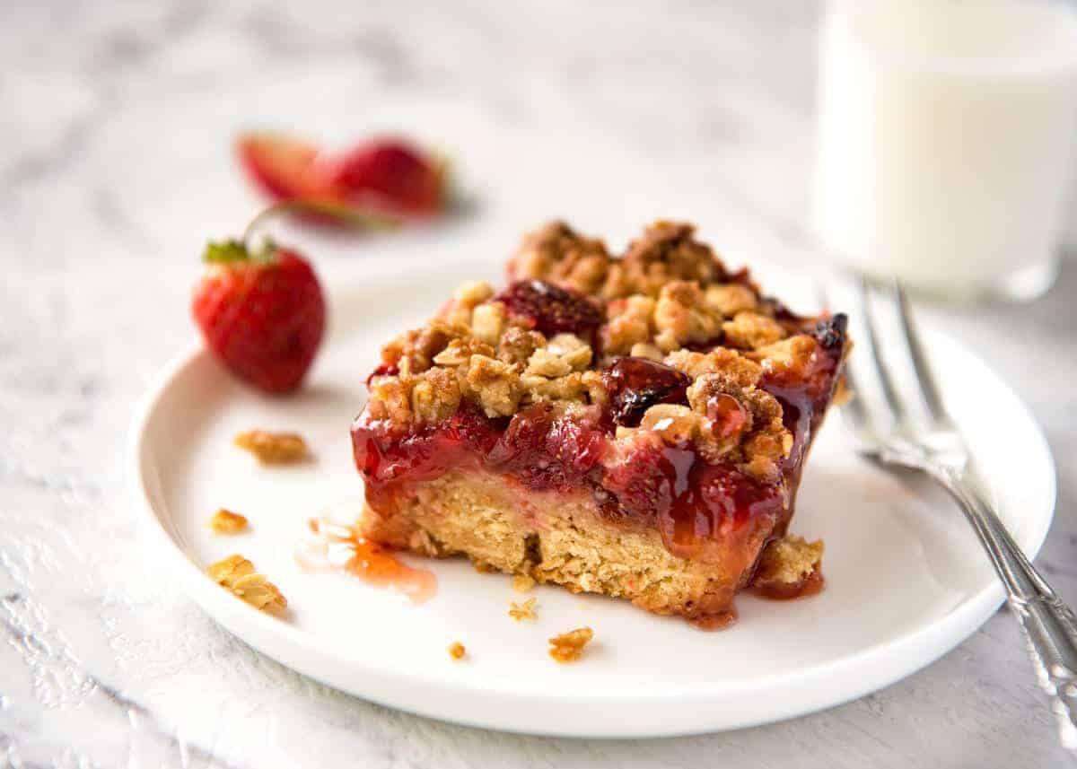 Fresh Strawberry Bars with a buttery biscuit base, topped with jam, fresh strawberries and a crumbly topping. No mixer, quick to make! www.recipetineats.com