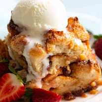 Bread and Butter Pudding in a bowl with ice cream, ready to be eaten