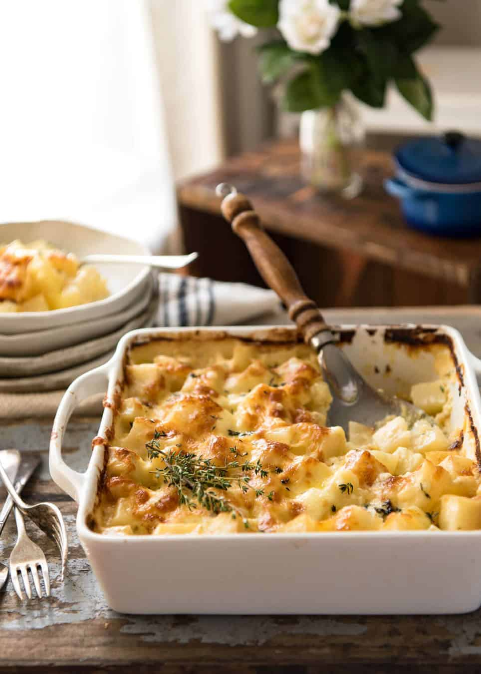 A faster, cheesier, creamier alternative to Scalloped Potatoes / Potato Gratin, this Easy Creamy Cheesy Potato Bake is made with cubed potatoes cooked in a cream and cheese sauce. recipetineats.com