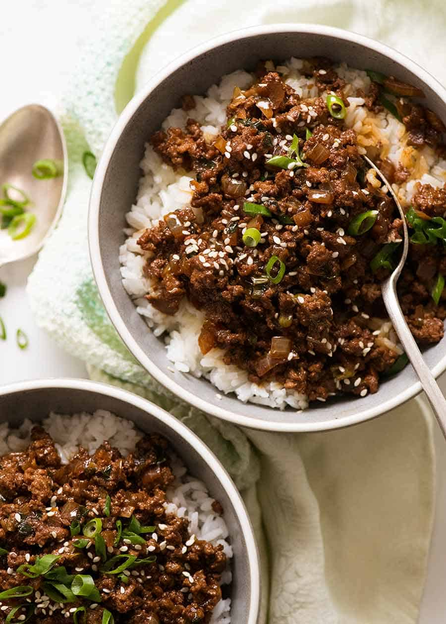 Overhead photo of Asian Ground Beef bowls served over rice in blue bowls