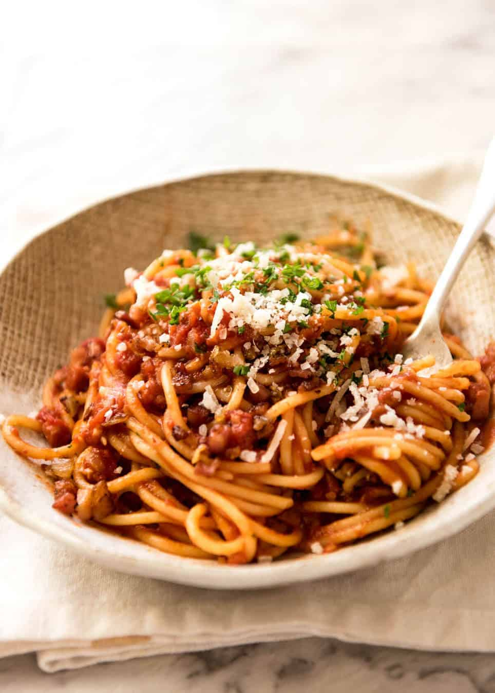 Simplicity at its best - Bacon Tomato Pasta. 5 ingredients. Utterly irresistible. recipetineats.com
