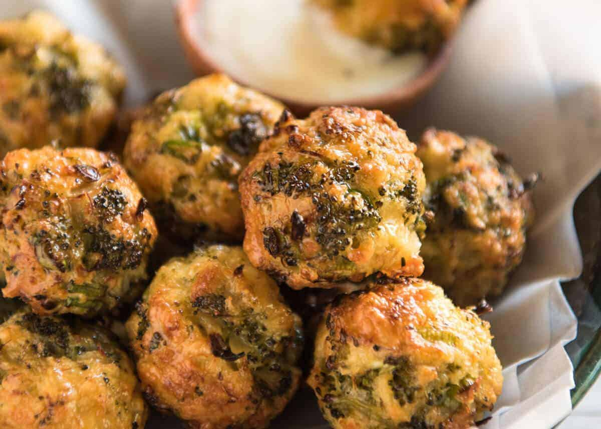Baked Broccoli Cheese Balls - outrageously delicious as a meal or bites to serve at a gathering! Served with a Yoghurt Lemon Sauce. recipetineats.com