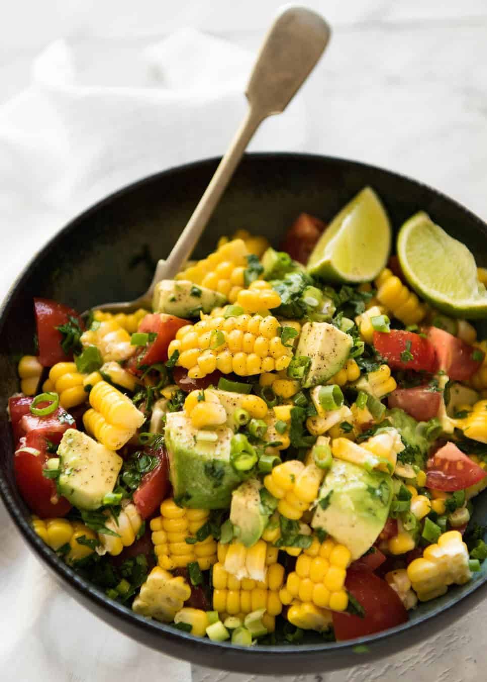 My favourite Corn Salad - made with fresh or canned corn, tomato, avocado, shallots/scallions, coriander/cilantro and a lime or lemon dressing. www.recipetineats.com
