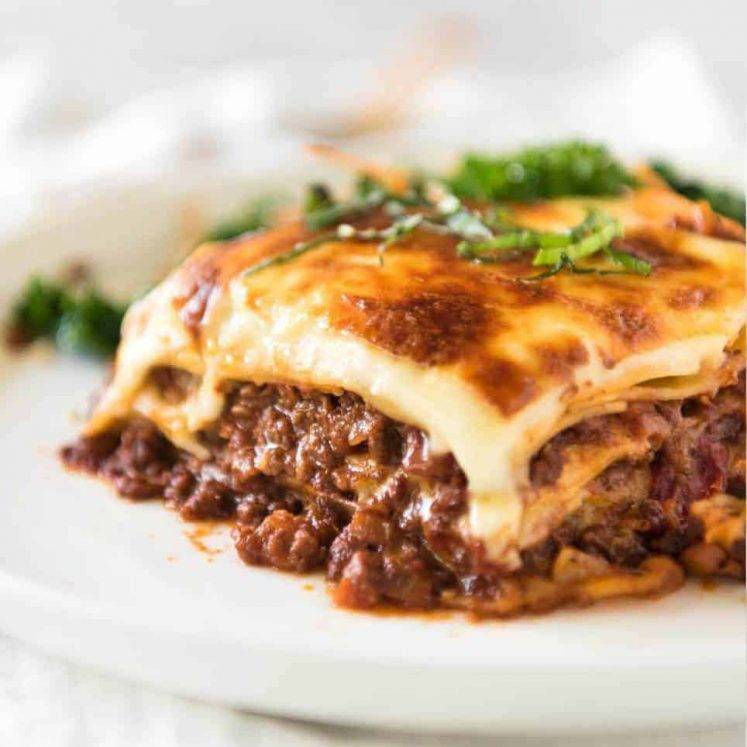 A homemade Lasagna is a thing of beauty! This is a traditional Italian Lasagna, made with a Bolognese Ragu and cheese sauce / béchamel sauce. No ricotta in sight! www.recipetineats.com