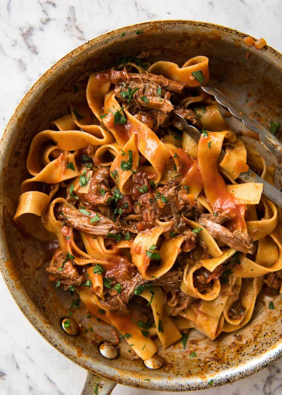 Rich, slow cooked Shredded Beef Ragu Sauce with pappardelle pasta. Stunning Italian comfort food at its best. recipetineats.com
