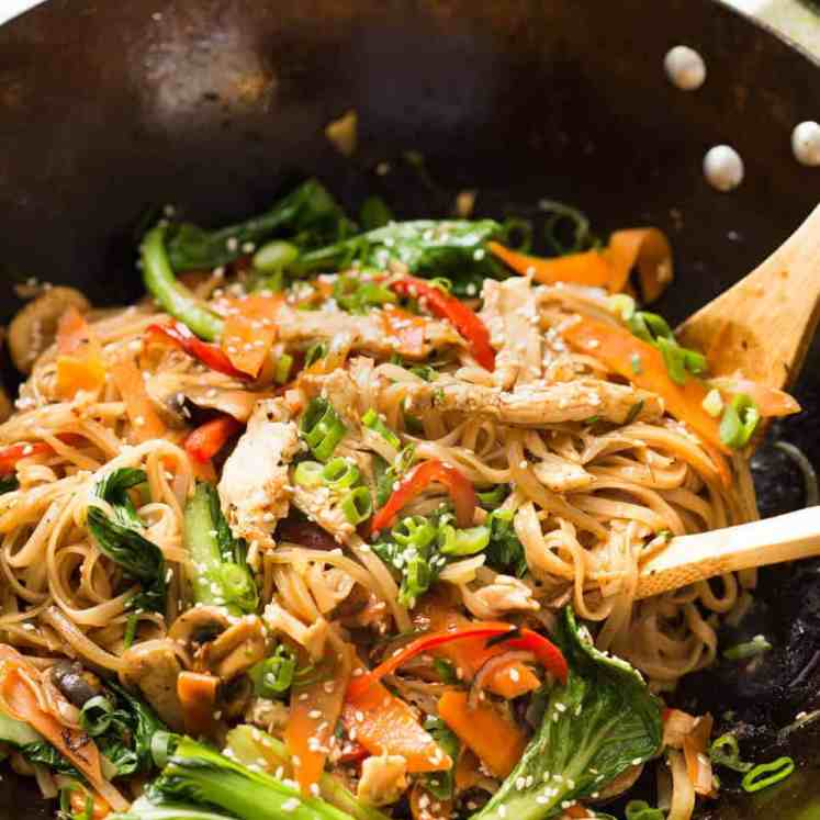 Great fridge forage meal - any dried noodles, any veggies, optional protein. This Chicken Stir Fry with Rice Noodles is healthy and super quick to make! recipetineats.com