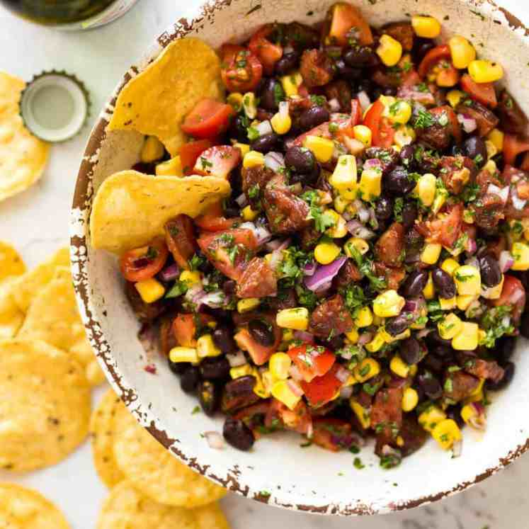 I call this a PIG OUT Salsa. Sensible people would call it an Chorizo, Black Bean and Corn Salsa. :) recipetineats.com