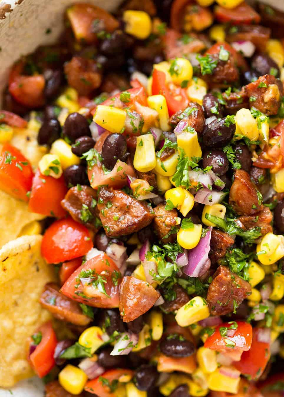 I call this a PIG OUT Salsa. Sensible people would call it an Chorizo, Black Bean and Corn Salsa. :) www.recipetineats.com