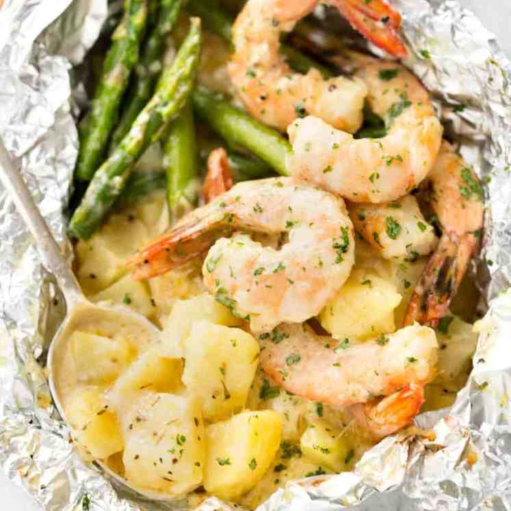 Creamy Garlic Shrimp, Cheesy Potatoes and asparagus - serious contender for the BEST foil packet recipe ever! recipetineats.com