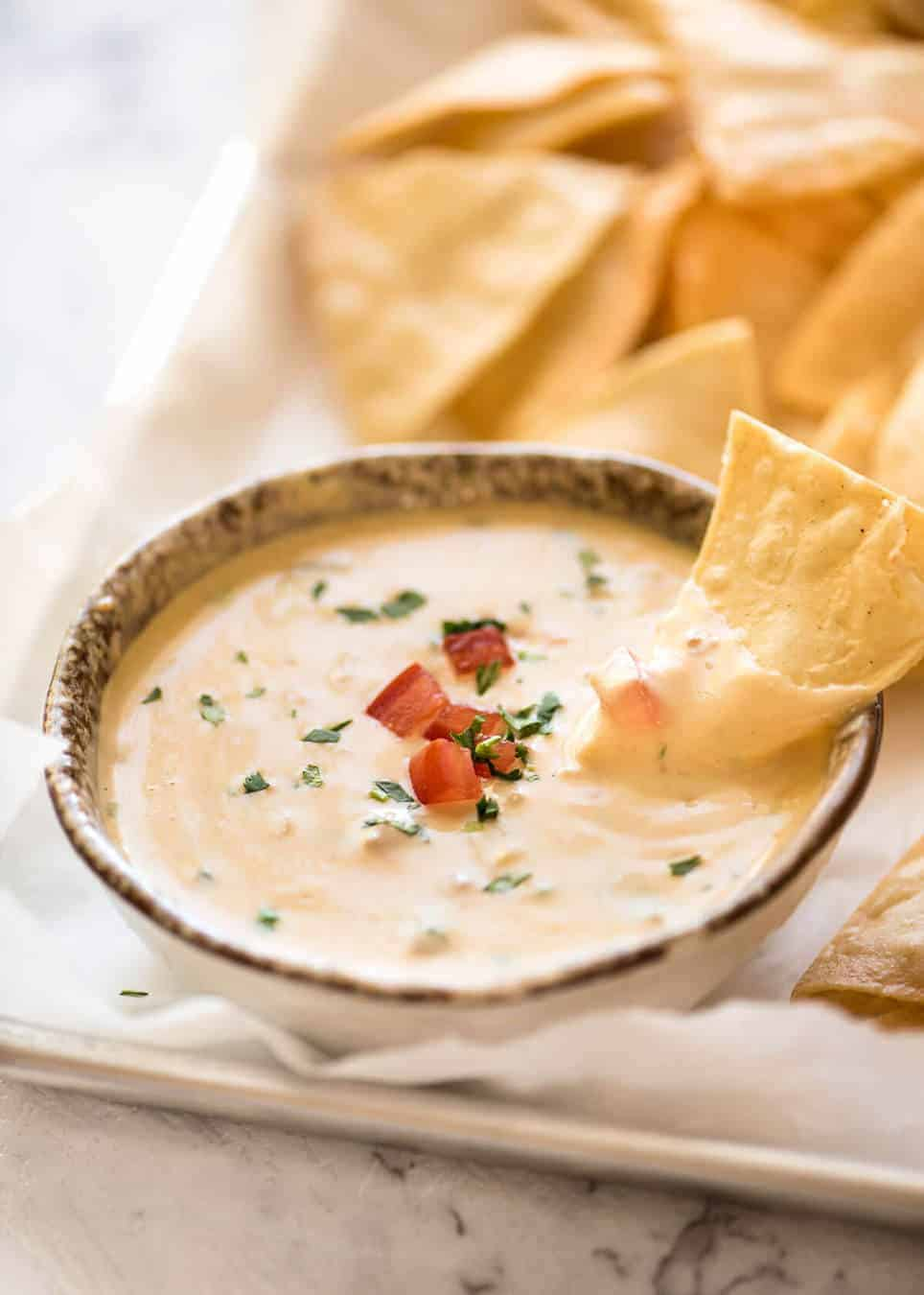 Code cracked: Queso Dip made with real cheese that's ultra silky even when it cools. recipetineats.com