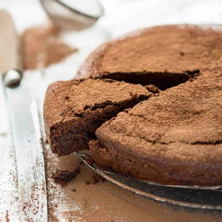 A simple Flourless Chocolate Cake made with almond meal / almond flour. Moist inside, with a thin crackly brownie-like surface. A stunning, very quick cake to make! www.recipetineats.com