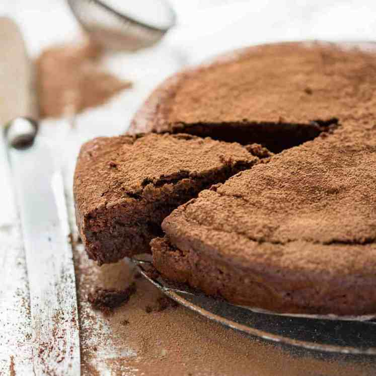 A simple Flourless Chocolate Cake made with almond meal / almond flour. Moist inside, with a thin crackly brownie-like surface. A stunning, very quick cake to make! recipetineats.com