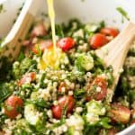 This Israeli Couscous Salad is fabulously addictive! Tender, flavour infused beads of couscous tossed with spinach, tomato, cucumber, herbs and a fresh lemon dressing. Summer in a bowl! www.recipetineats.com