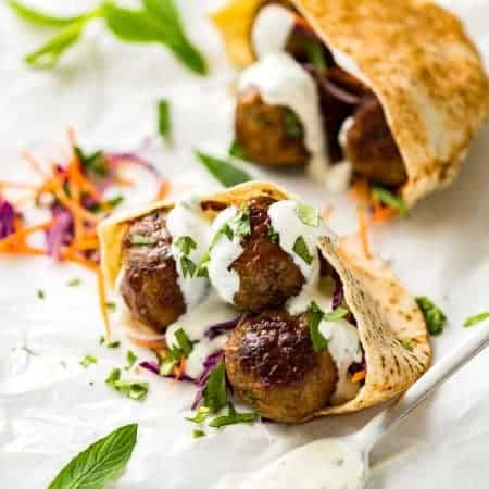 Plump, juicy, beautifully spiced Moroccan Lamb Meatballs with Minted Yoghurt. Great for stuffing in pita pockets! www.recipetineats.com