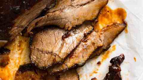 Close up of ultra tender Beef Brisket slices with BBQ Sauce.