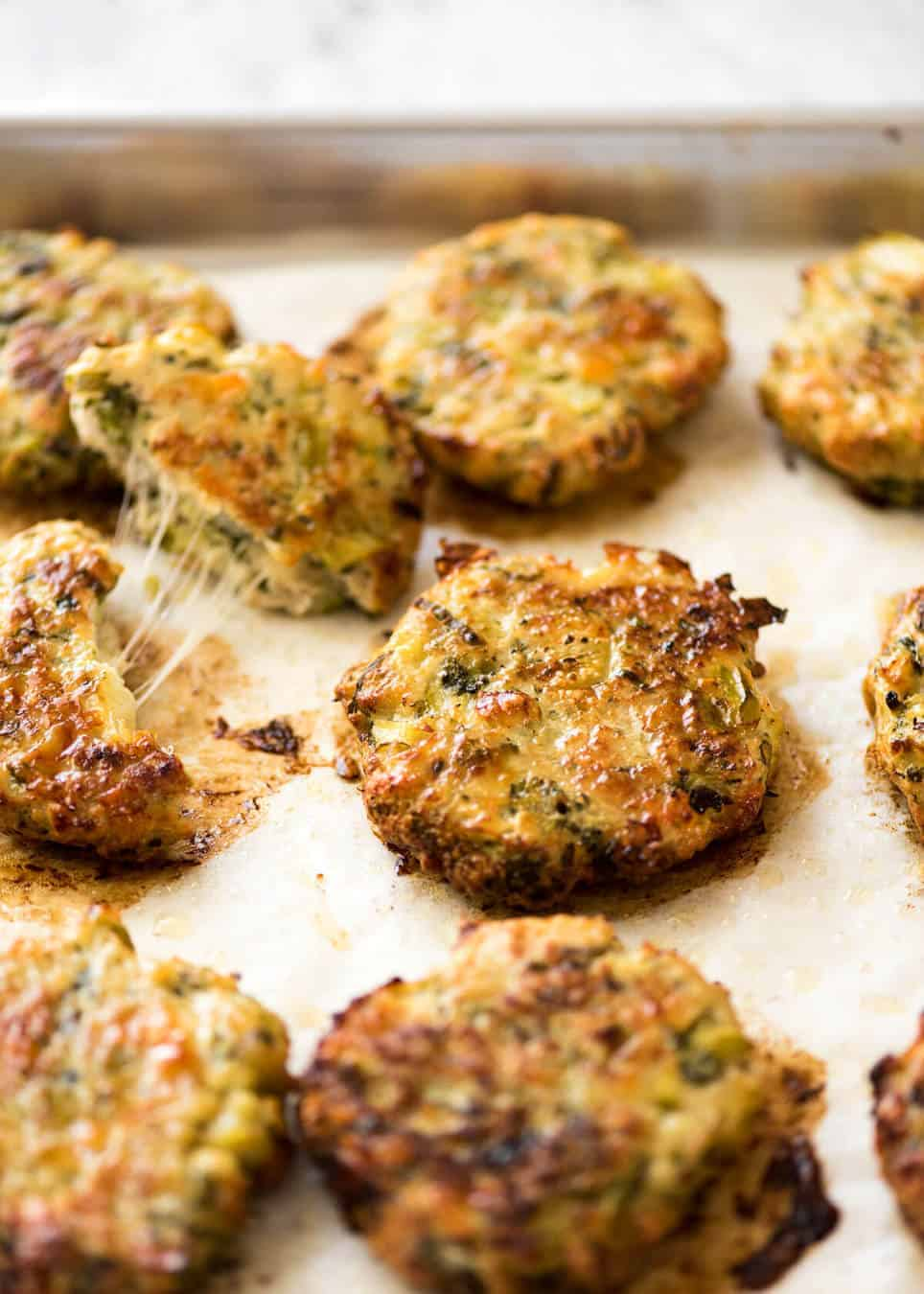Golden and crispy on the outside, juicy and cheesy on the inside - BAKED Cheesy Broccoli Chicken Patties. www.recipetineats.com