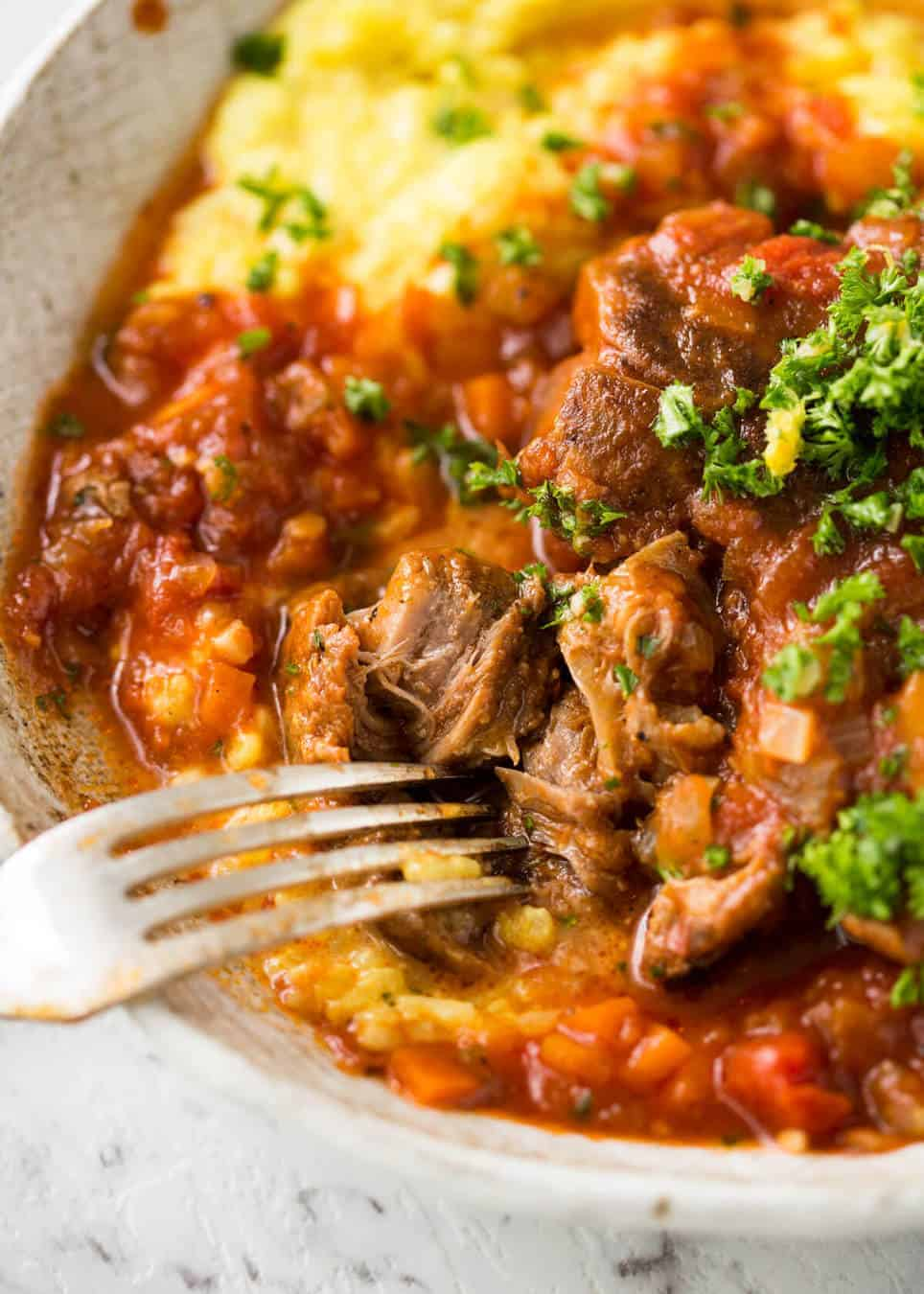 Fork tender veal braised in a rich red sauce, Osso Buco is a meal fit for a king! www.recipetineats.com