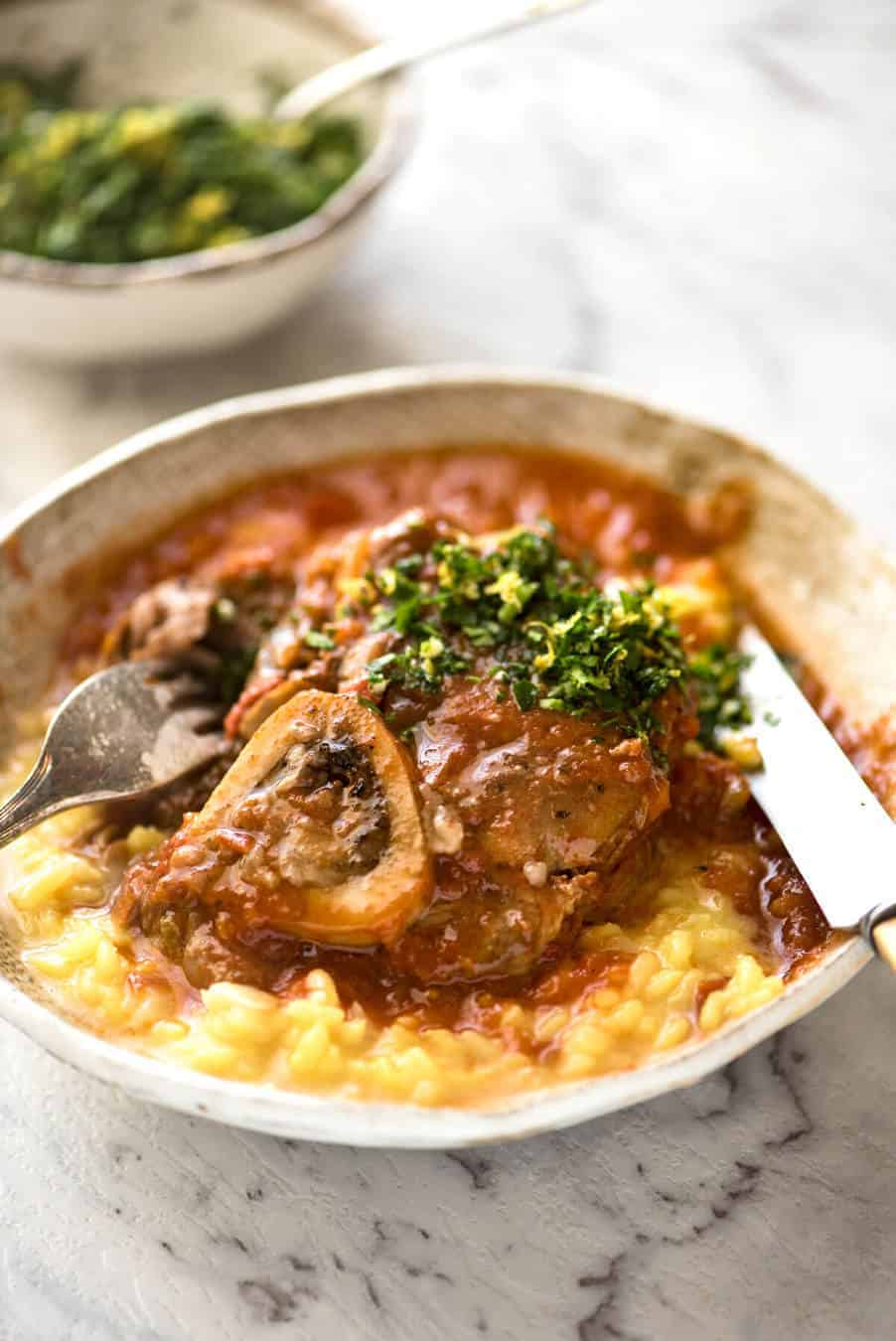 Fork tender veal braised in a rich red sauce, Osso Buco is a meal fit for a king! recipetineats.com