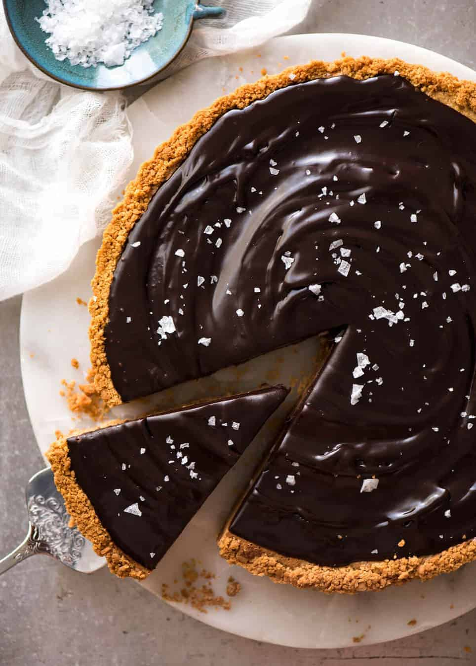 A sinfully decadent Salted Caramel Tart with a creamy soft salted caramel filling topped with luxurious chocolate ganache. Just SIX ingredients! www.recipetineats.com