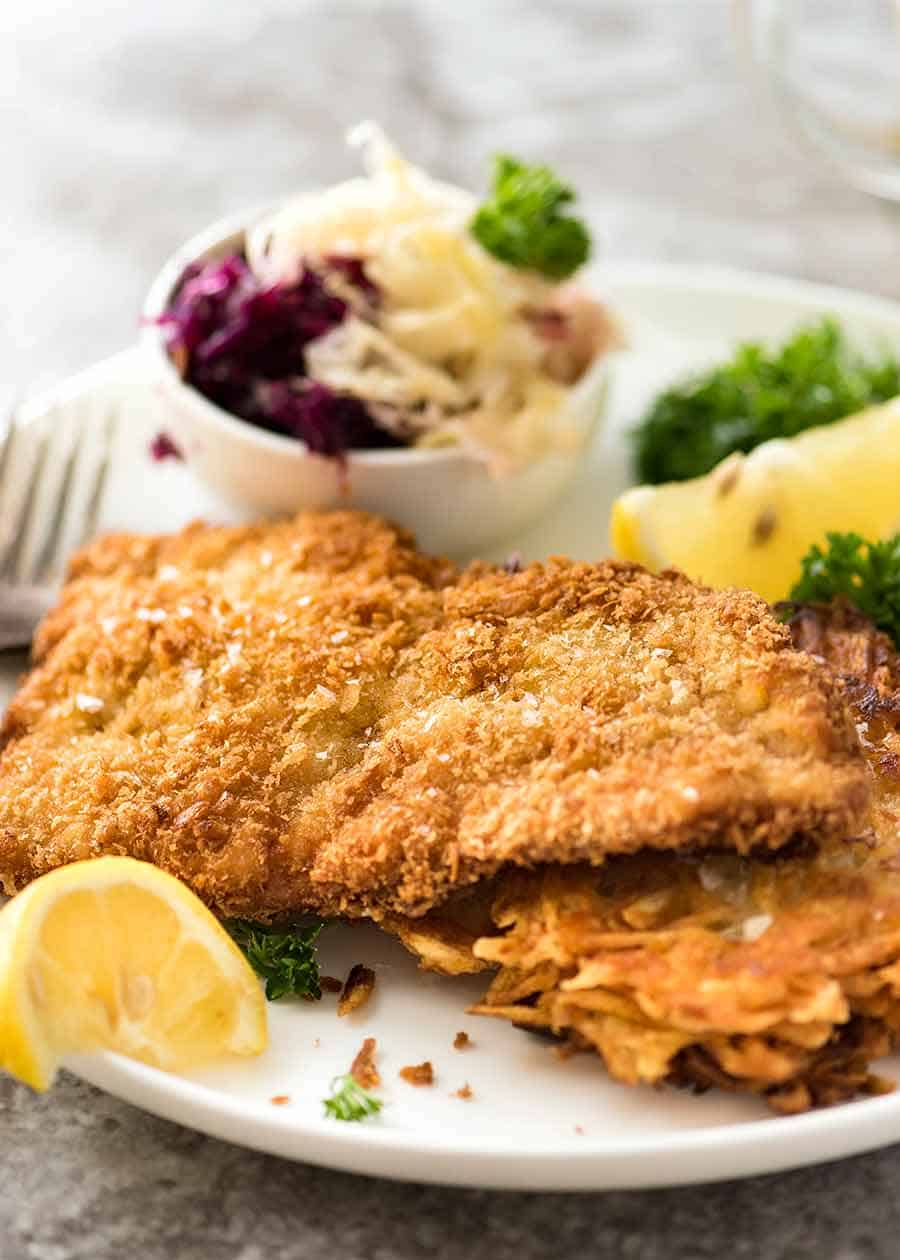 Close up of Schnitzel on a plate with crispy potato rosti