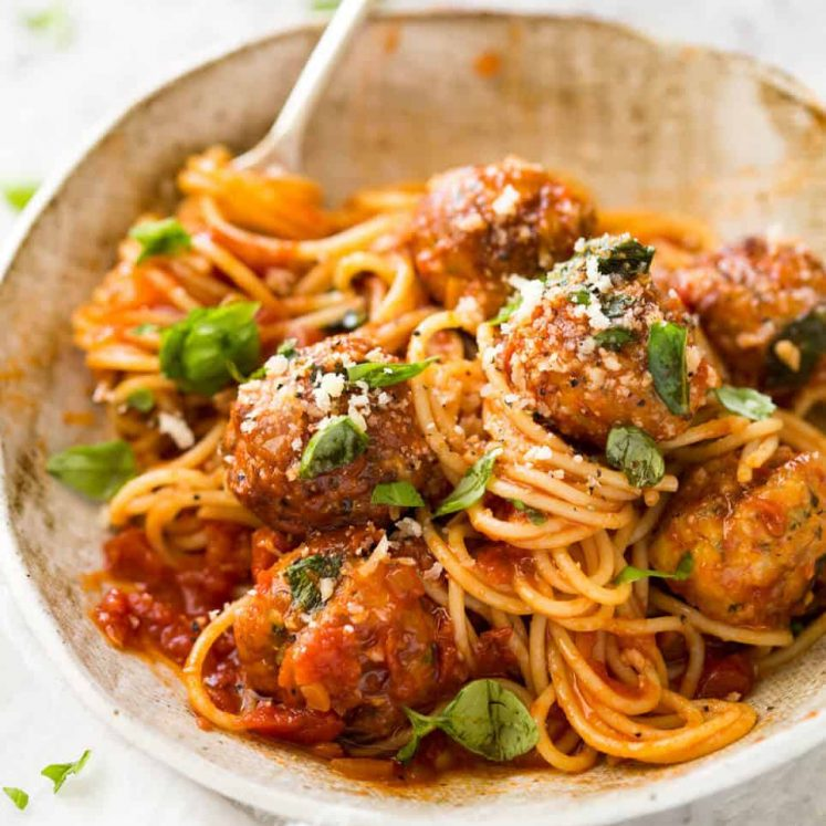 Plump, juicy BAKED Chicken Meatballs and Spaghetti! They come out golden brown on the outside, and so soft and juicy on the inside. www.recipetineats.com