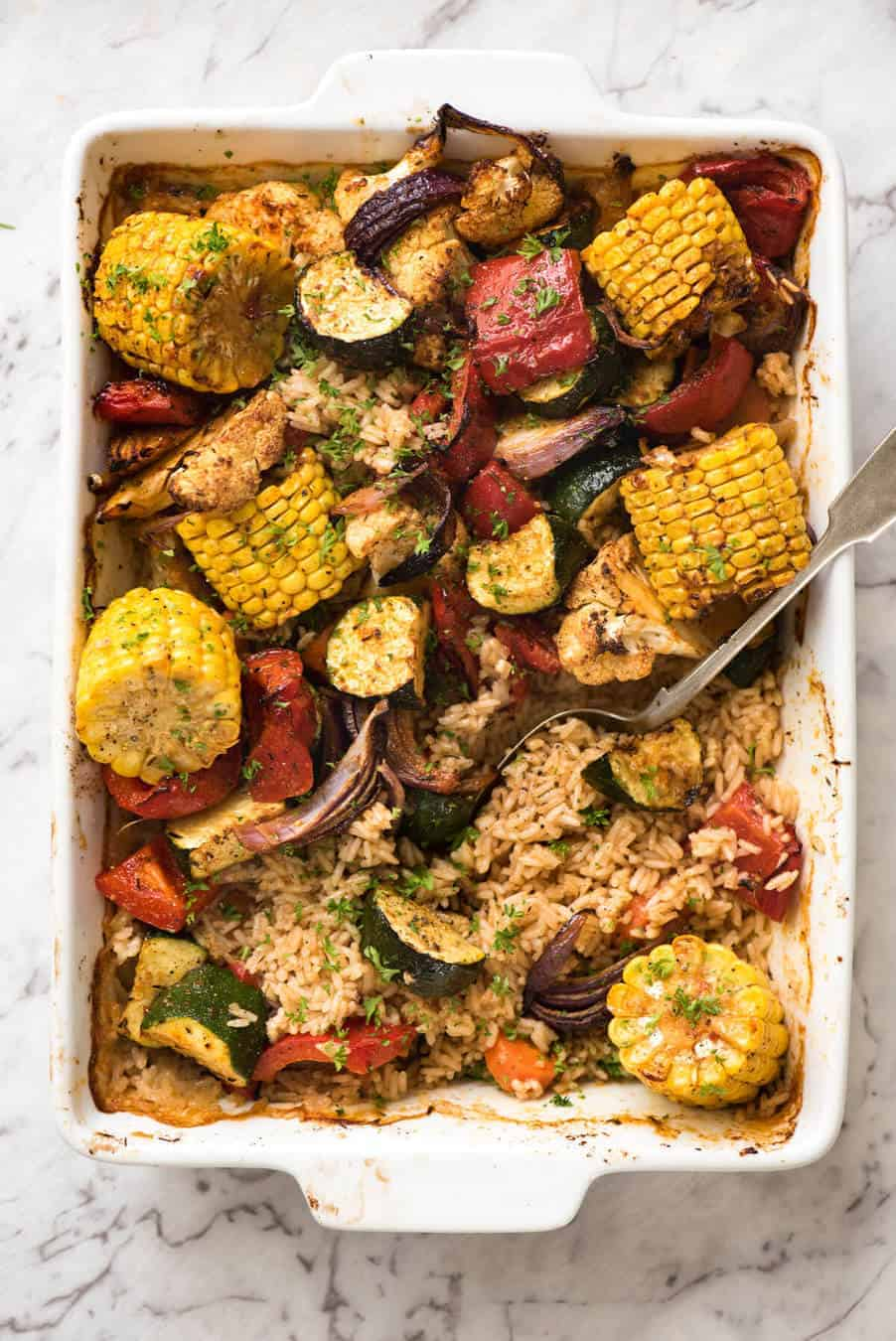Oven Baked Rice and Vegetables - Fluffy seasoned rice and oven roasted vegetables, all made in ONE pan! Fabulous meal or side, super quick and easy to prep. www.recipetineats.com