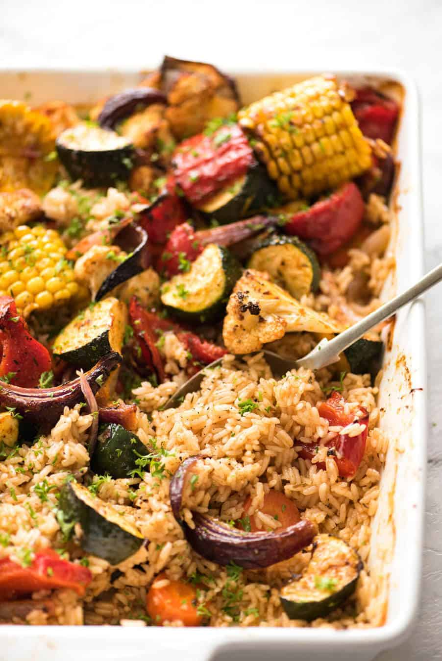 Oven Baked Rice and Vegetables - Fluffy seasoned rice and oven roasted vegetables, all made in ONE pan! Fabulous meal or side, super quick and easy to prep. recipetineats.com