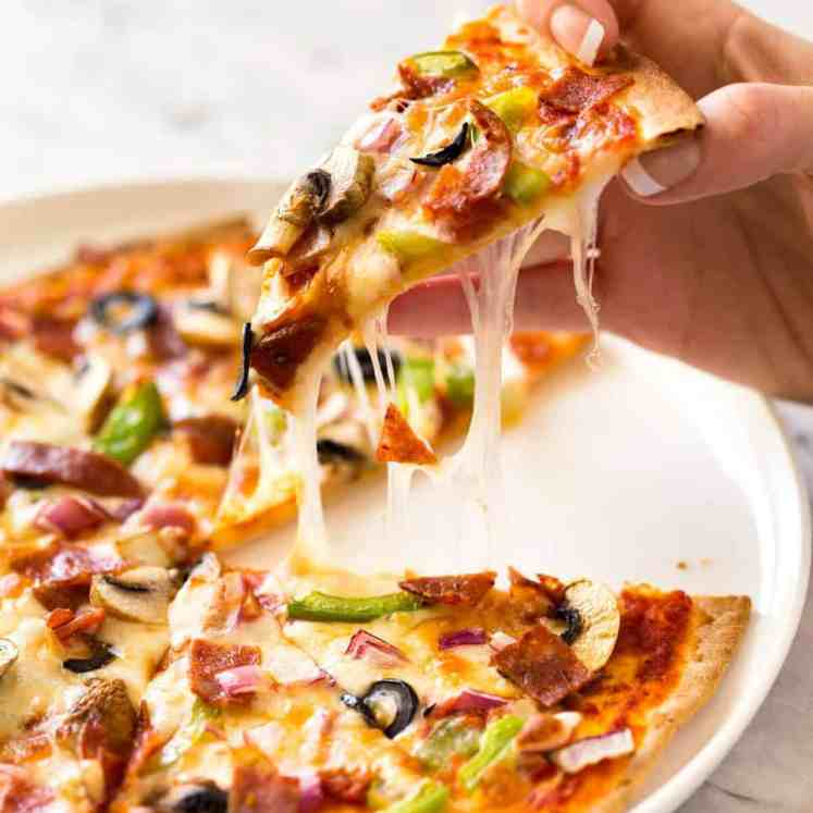 $2 Homemade Frozen Pizzas - quick and easy made using flatbreads, cook from frozen for a terrific Thin & Crispy pizza! recipetineats.com