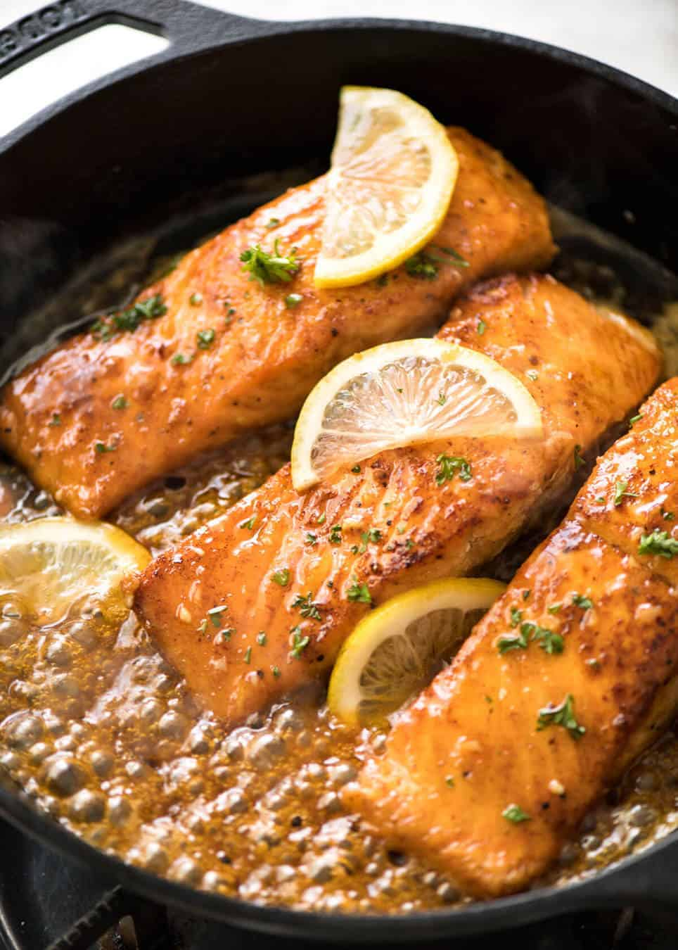 If this Lemon Honey Glazed Salmon takes more than 8 minutes to make, you've overcooked the salmon. That sauce is lip smackingly delicious! www.recipetineats.com