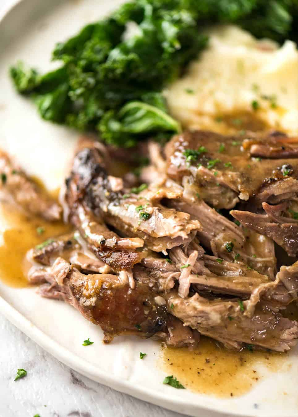 Slow Roast Leg of Lamb - ultra easy, ultra tender meat to pull off the bone, served with a luscious gravy. www.recipetineats.com