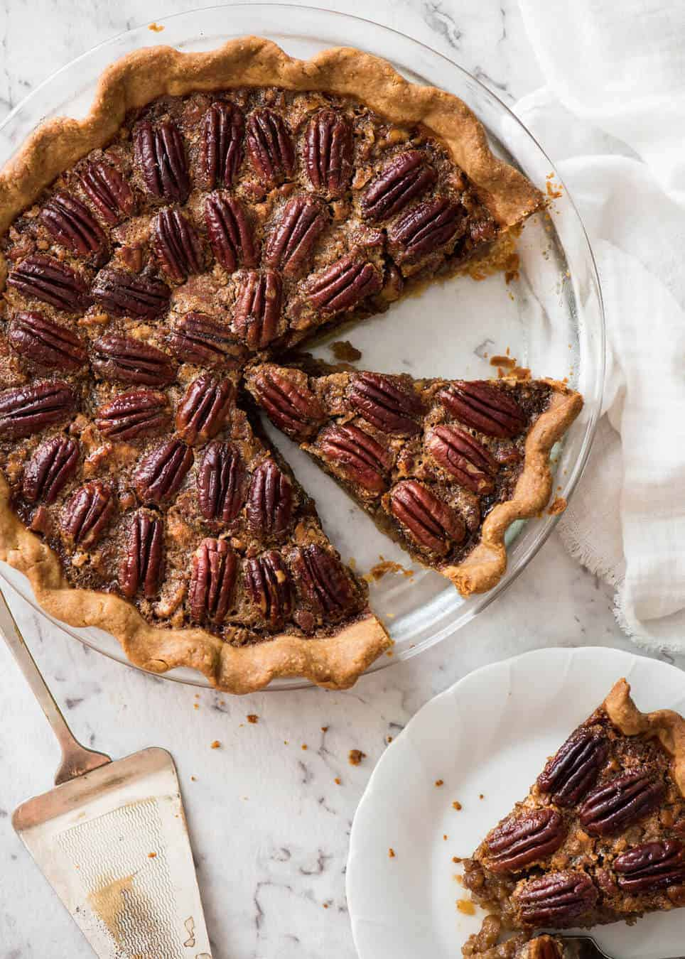 Learn how to make Pecan Pie, the great American classic! Flaky all-butter pie crust with a soft set filling, the quick video tutorial will be very helpful will guide you to nail this every time! recipetineats.com