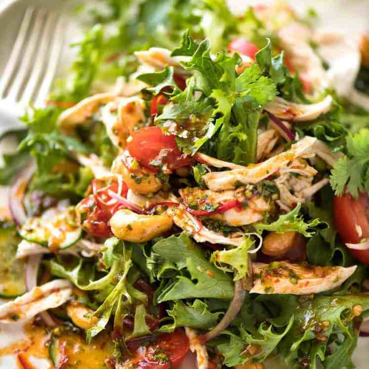 Thai Chicken Salad with a bright zesty Chilli Lime Dressing, classic balance of Thai tangy-sweet-salty flavours. recipetineats.com