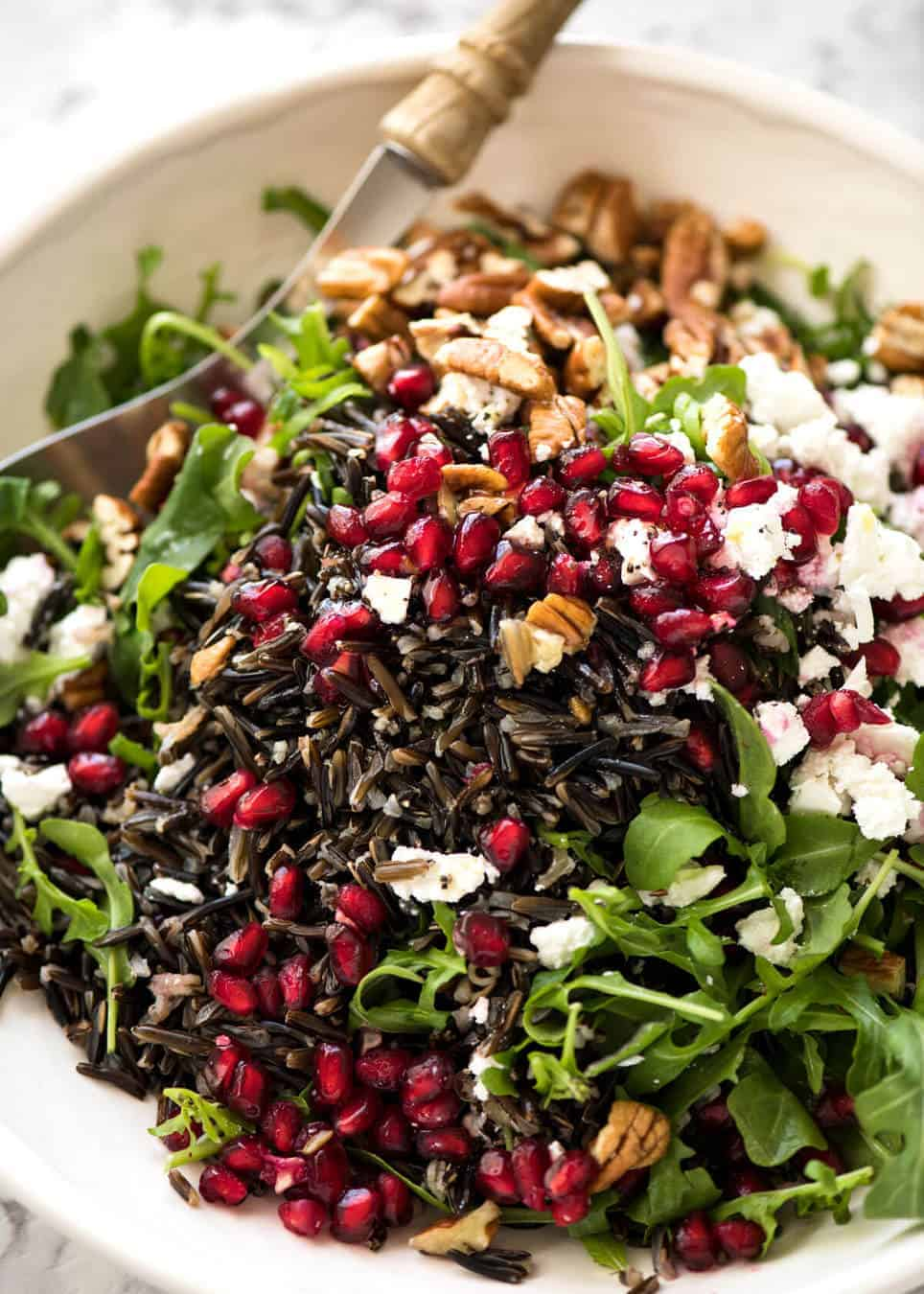 This Wild Rice Salad is a salad for celebrations! Stellar flavour combination - wild rice, pomegranate, pecans, rocket / arugula, green onions, cranberries and feta. recipetineats.com