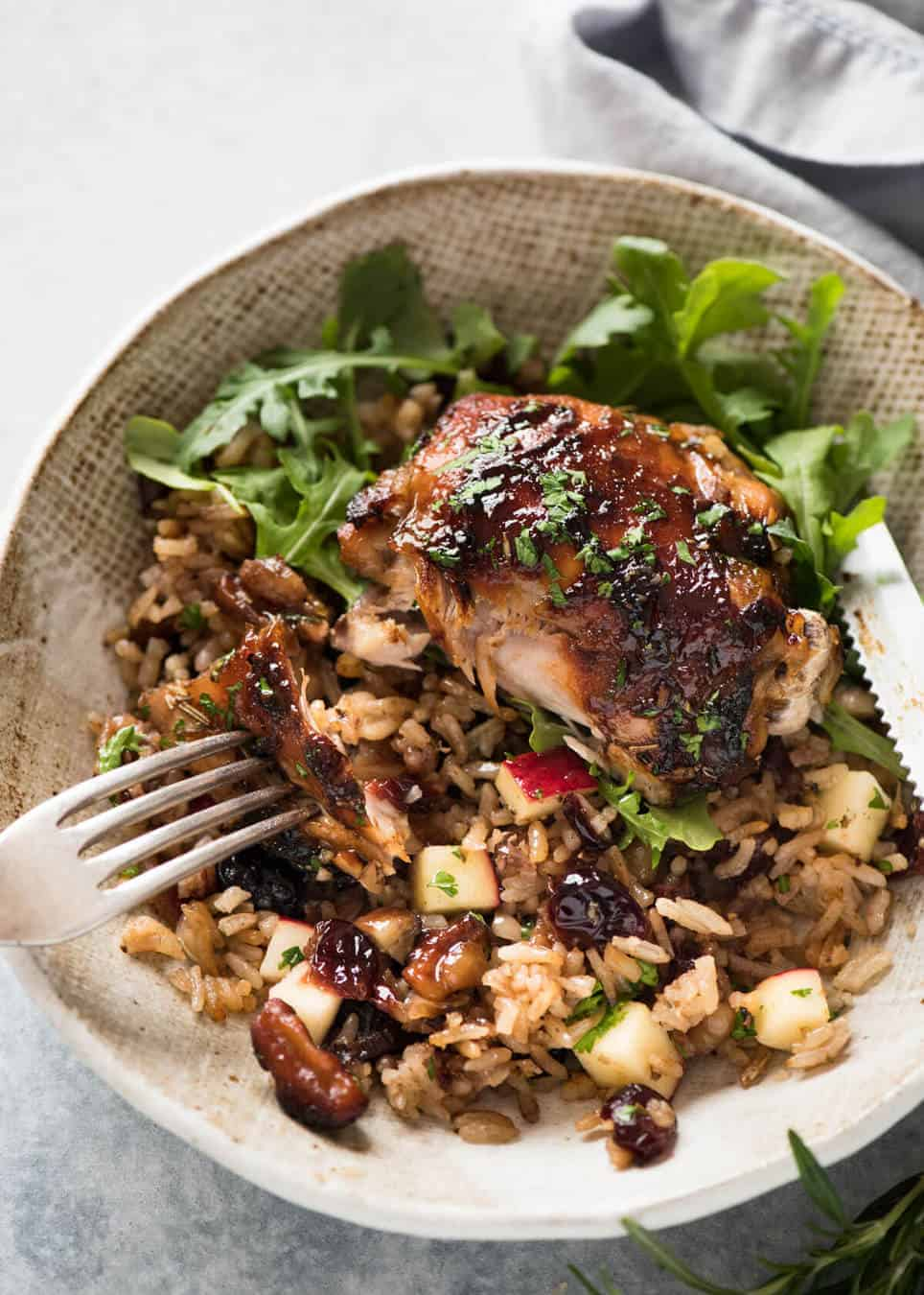 A flavour loaded one-pan, quick midweek dinner - Baked Chicken and Rice Pilaf with Cranberries, Walnuts and Apple. The smell when this is cooking is amazing! www.recipetineats.com