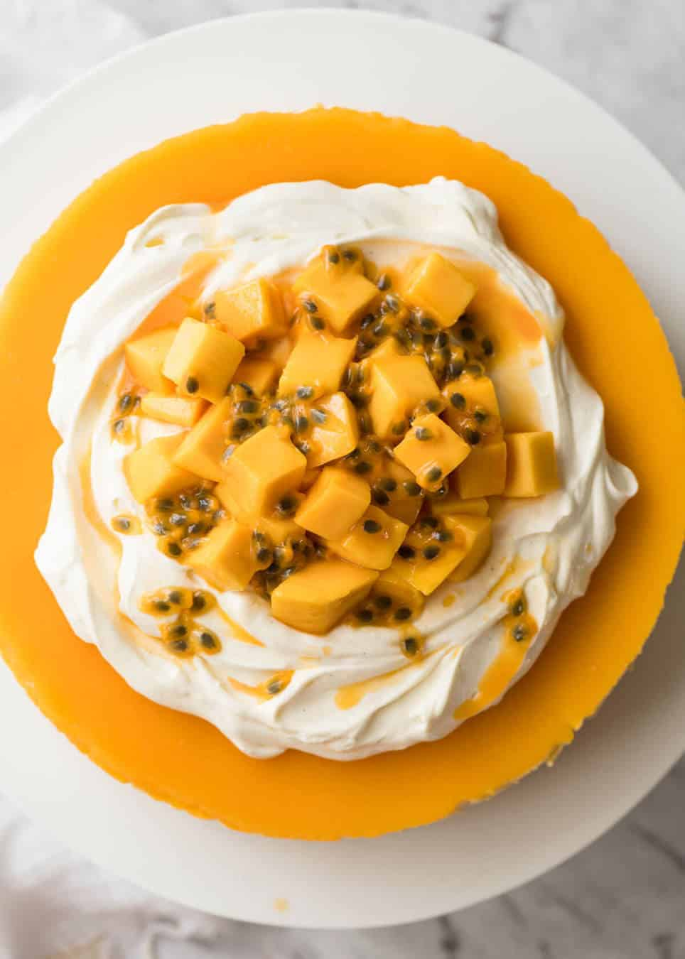 Toppings to decorate mango cheesecake - cream, passionfruit and mangoes. www.recipetineats.com