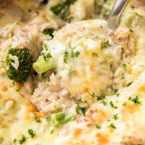 Close up of spoon scooping up One Pot Chicken Broccoli Rice Casserole
