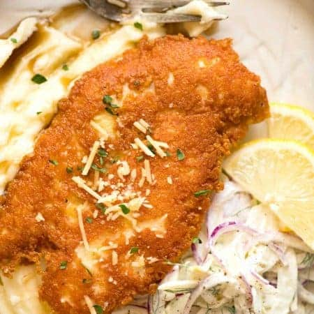 Parmesan Crusted Chicken Breast - golden brown and crispy on the outside, juicy on the inside.