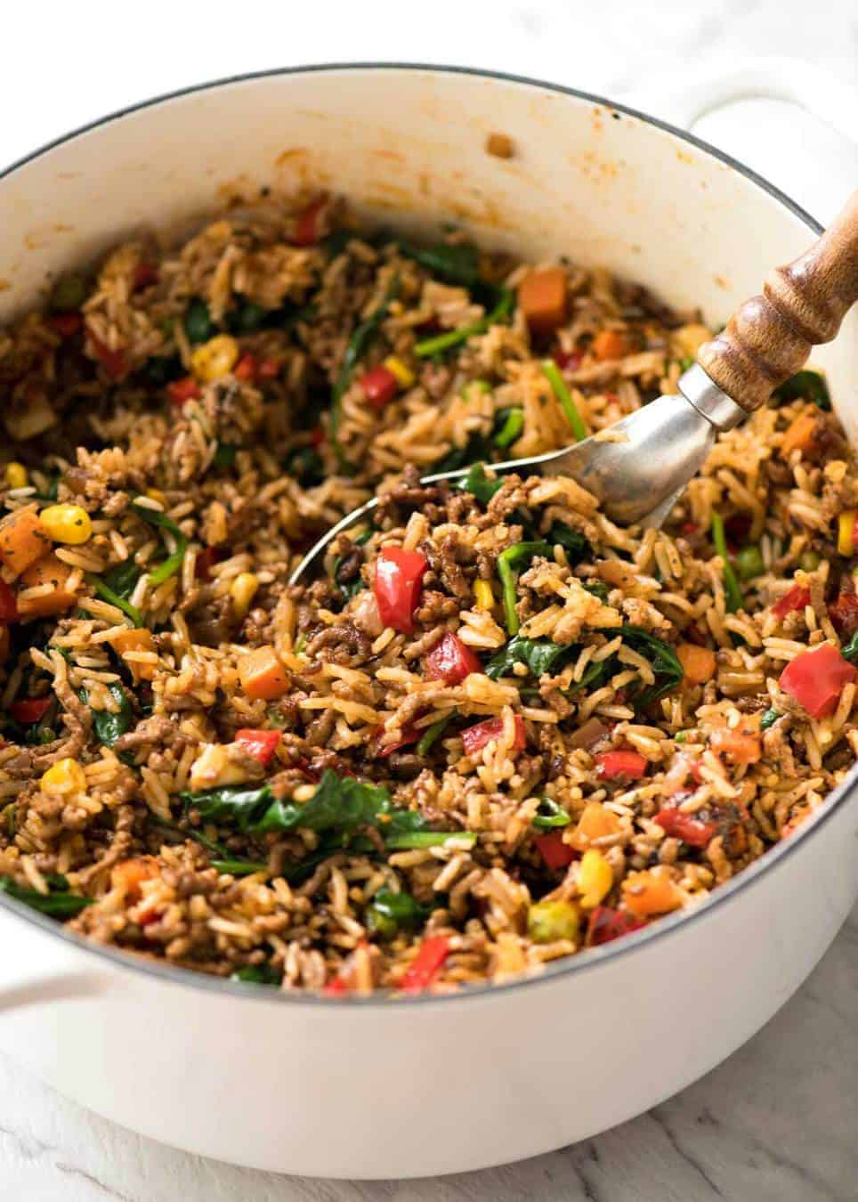 A quick, fabulous midweek meal - this ground Beef and Rice is made by browning ground beef, then cooking it with flavoured rice and loads of veggies. Irresistibly delicious! www.recipetineats.com