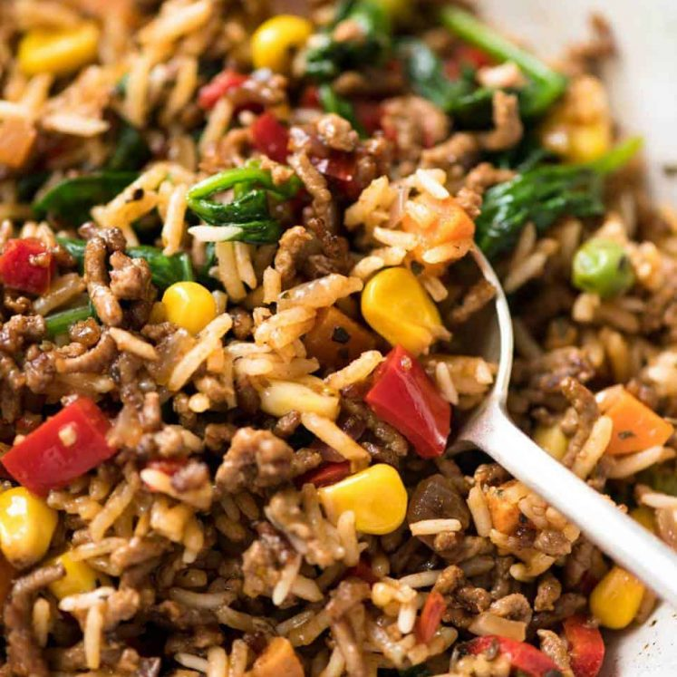 One Pot Ground Beef and Rice with loads of veggies - Browned beef cooked with seasoned rice and vegetables. A fast, super tasty complete meal! www.recipetineats.com