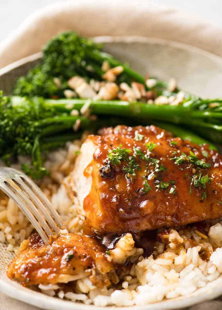 Honey Garlic Chicken with sauce served over rice with steamed broccolini