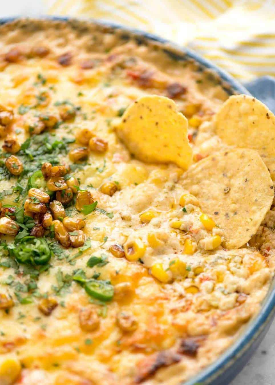 Essential Super Bowl food - a big batch Hot Corn Dip that's made for eating with eyes glued to the TV screen.