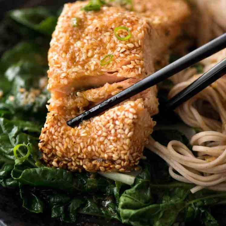 Just roll the salmon in sesame seeds, drizzle with oil and bake! You'll be amazed how well the sesame adheres to the salmon and love how crispy this Sesame Salmon comes out!