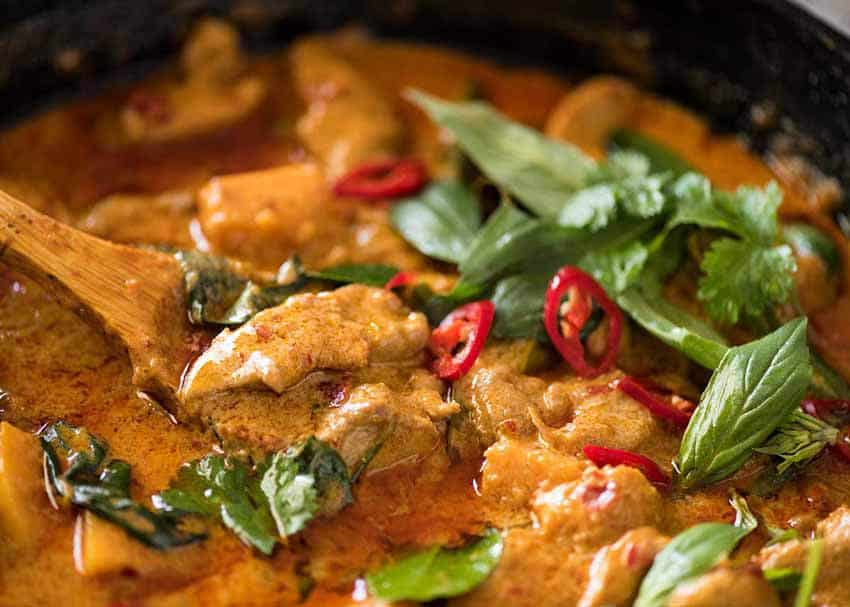 Close up of Thai Red Curry with Chicken in a black skillet