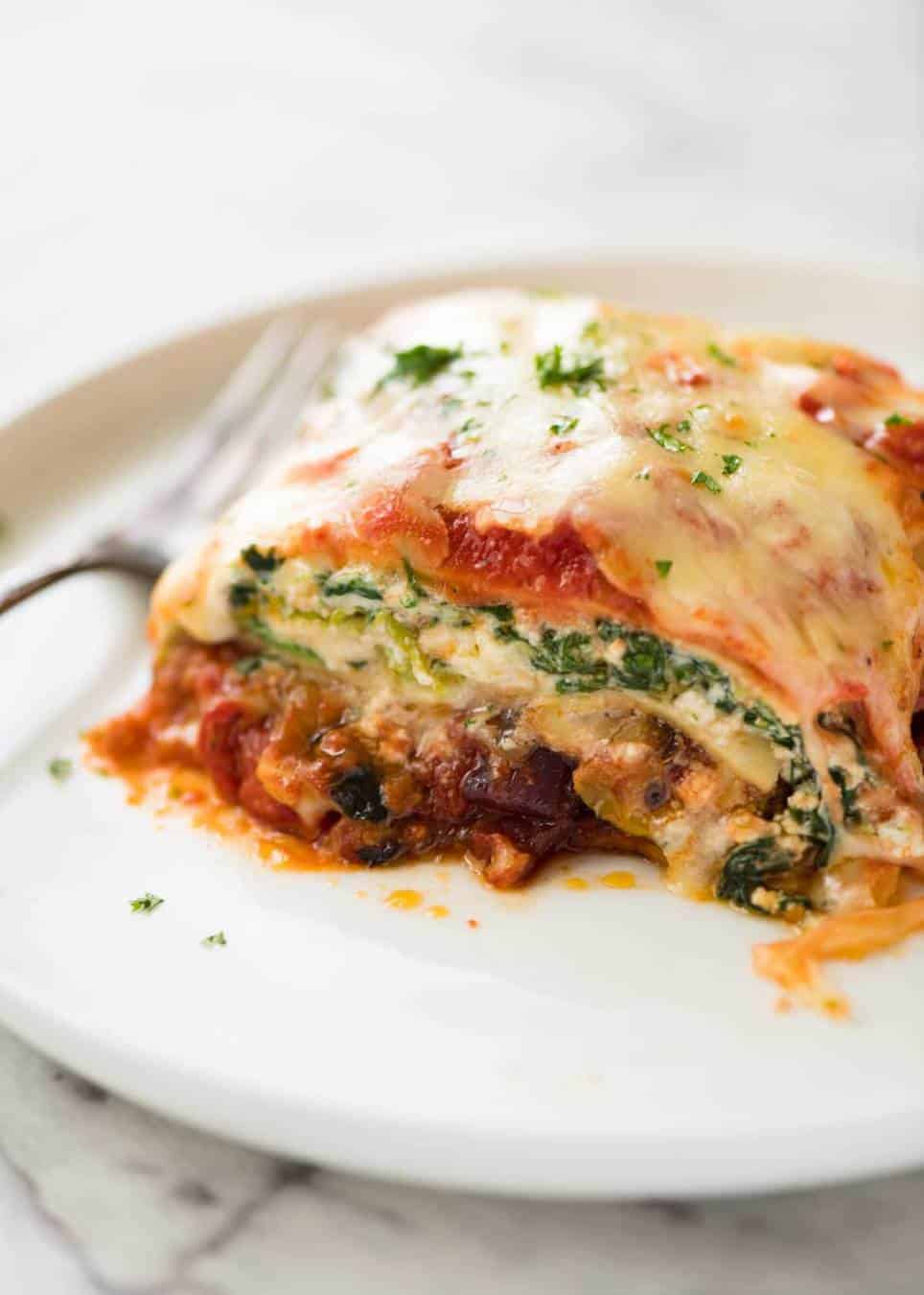 A wonderful Vegetarian Lasagna with layers of roasted vegetables, tomato sauce, and a spinach ricotta filling. www.recipetineats.com
