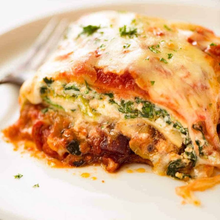 Close up of Vegetarian Lasagna on a white plate, ready to be eaten