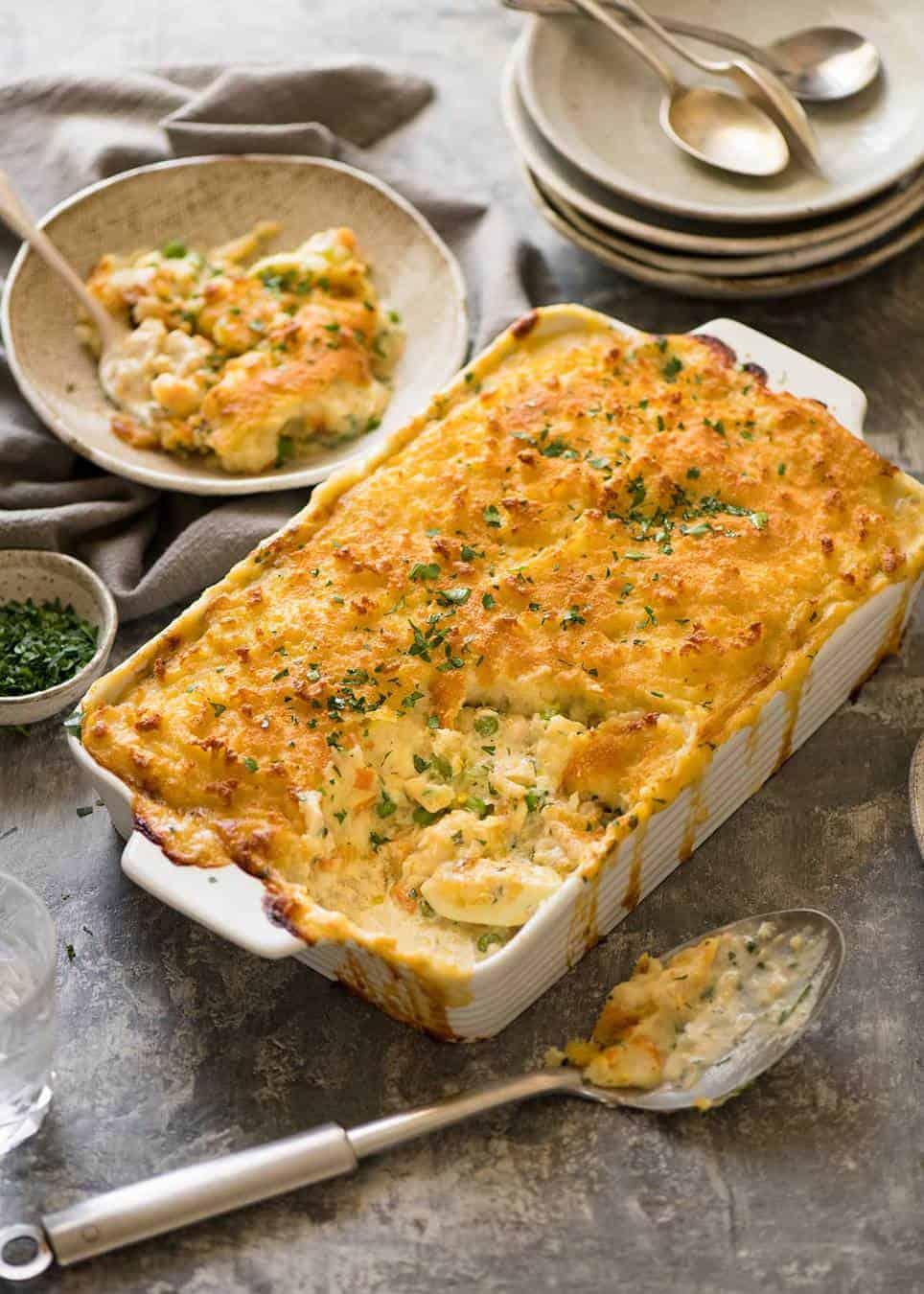 Fish Pie in white baking dish with serving plates