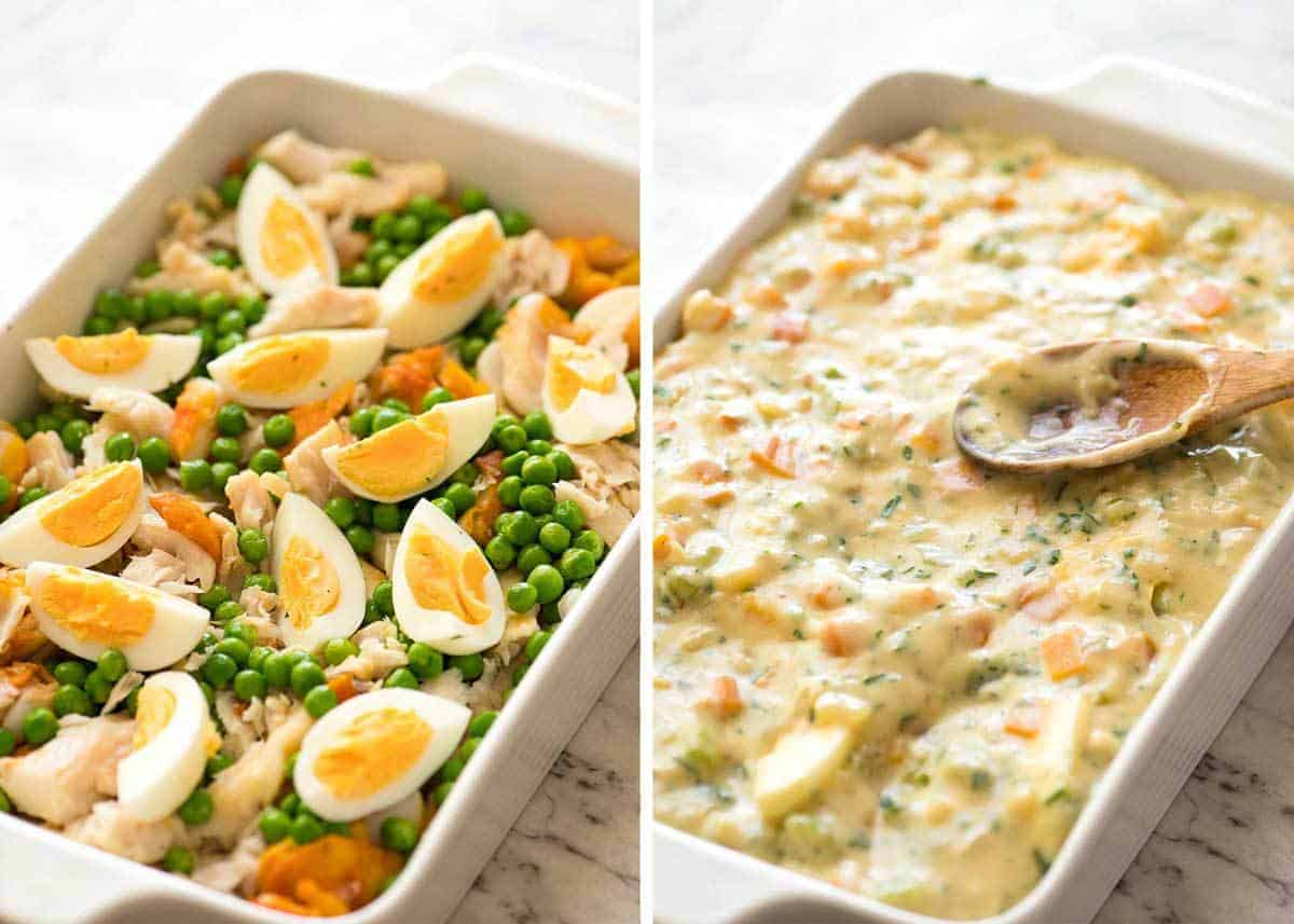 Fish pie filling in white baking dish with creamy white sauce