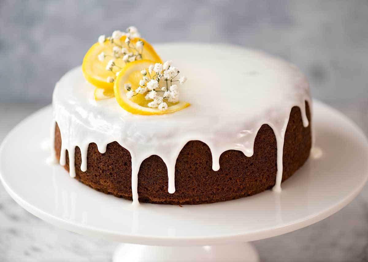 Lemon Cake with Lemon Glaze on a cake stand.